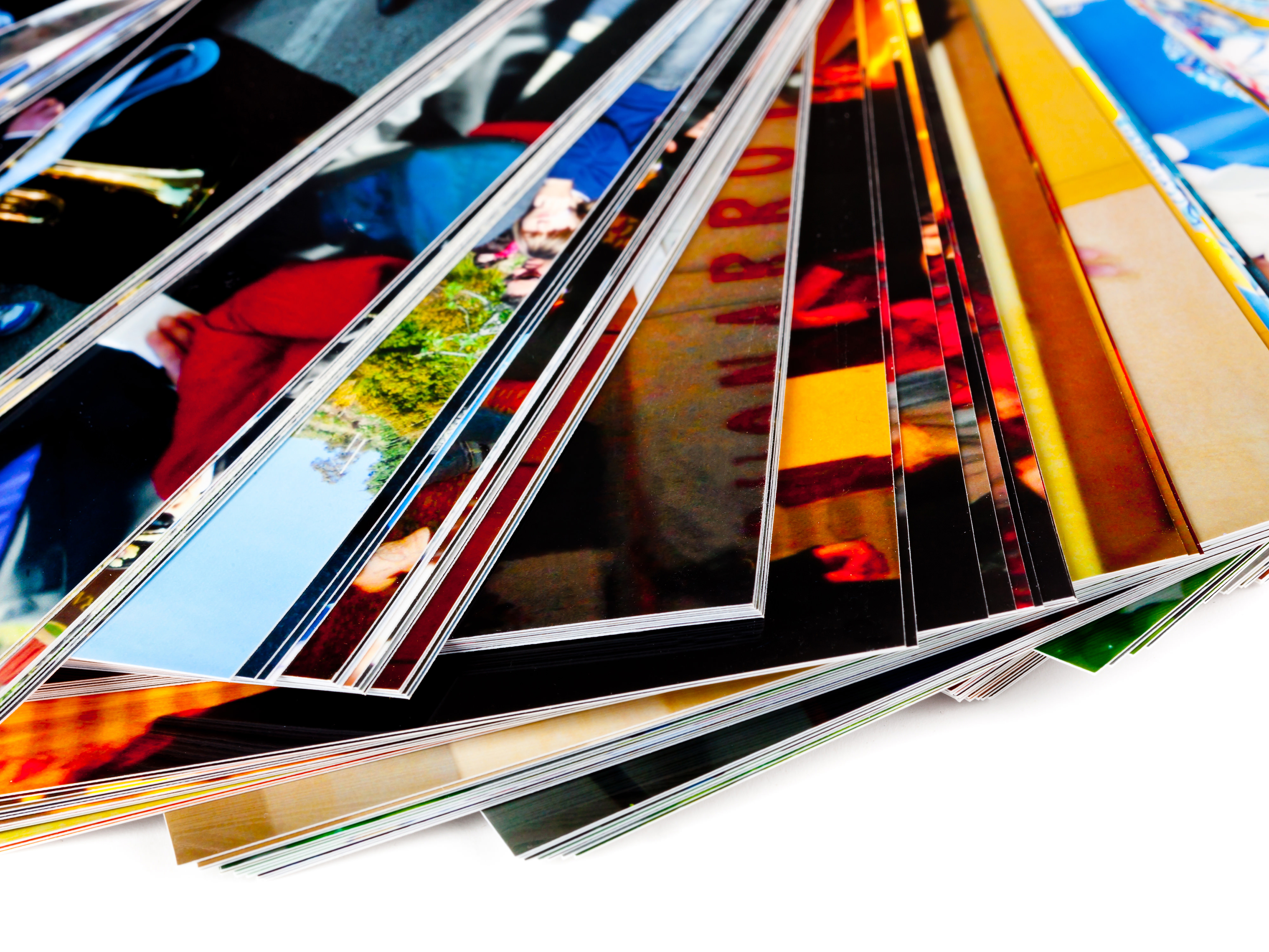 Stack of the photos, isolated on a white background.